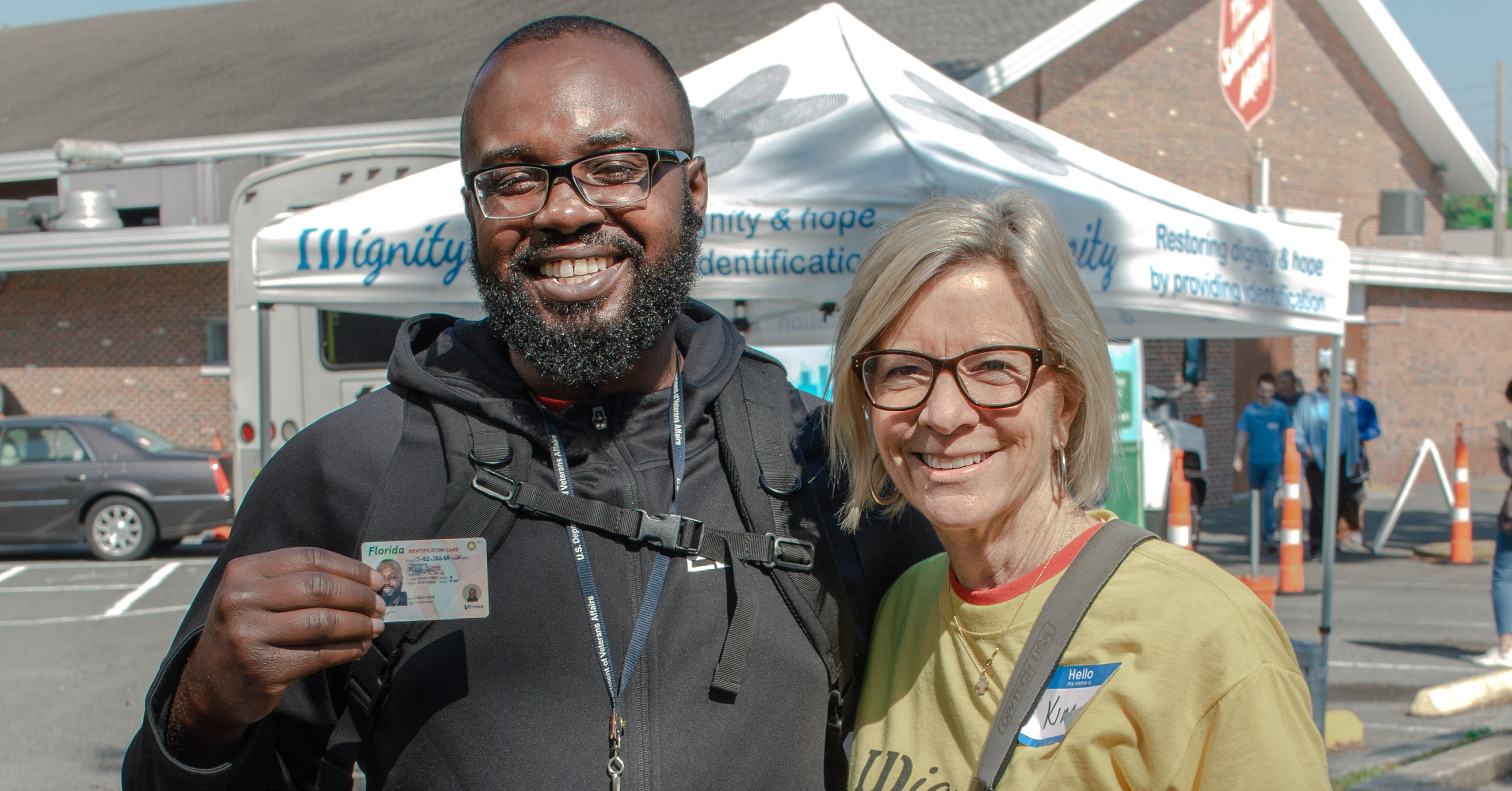 A client and volunteer celebrate another new ID