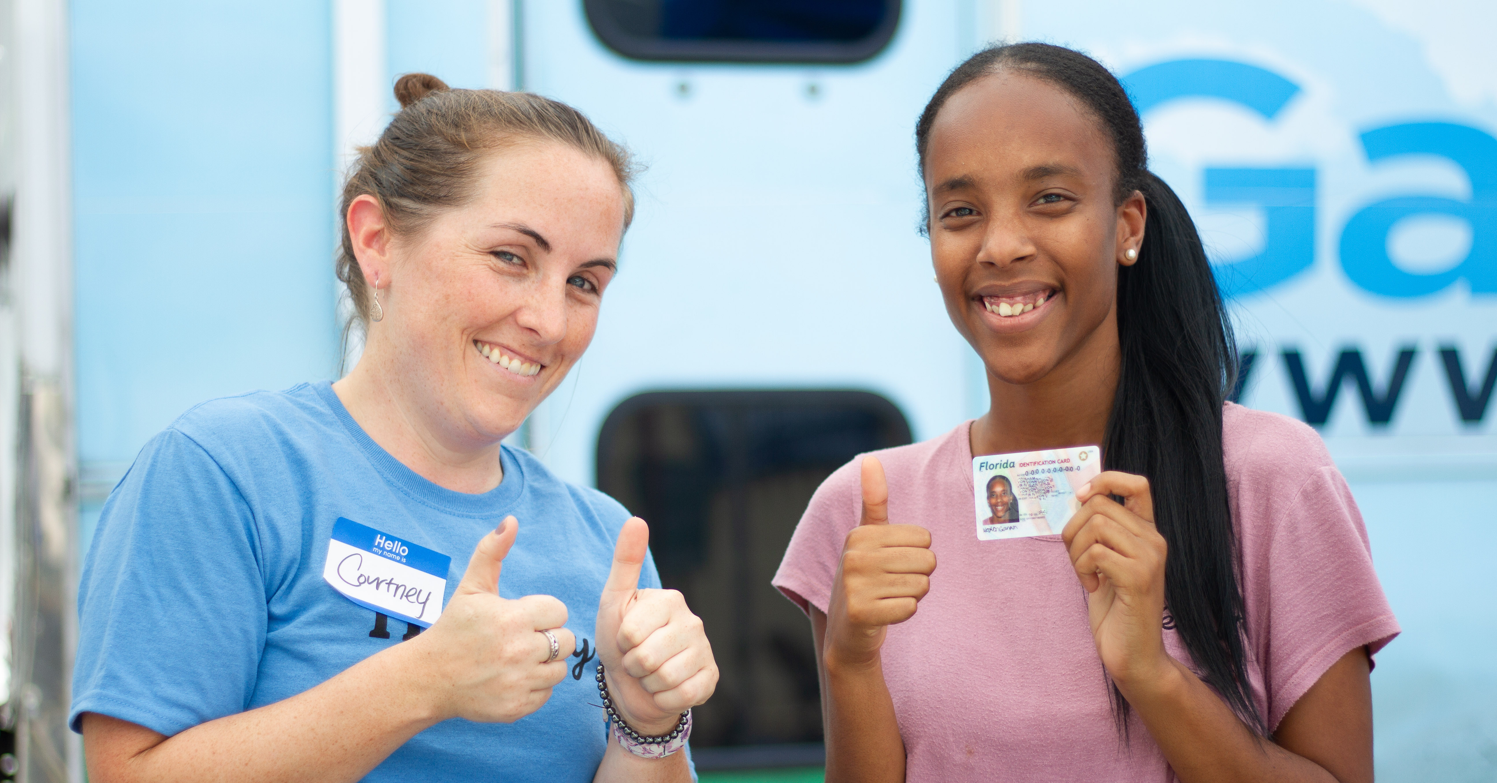 A client and volunteer celebrate another fresh ID