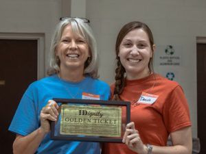 Diana and Program Manager Danielle Landaal holding Diana's Golden Ticket award
