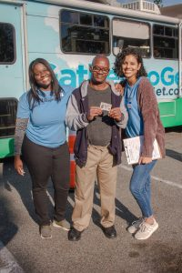 IDignity client and two volunteers celebrate this client's new identification card