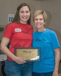 IDignity Volunteer, Susu, showing off her Golden Ticket award.