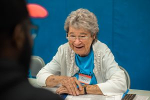 IDignity Volunteer, Patsy, smiles as she chats with an IDignity client