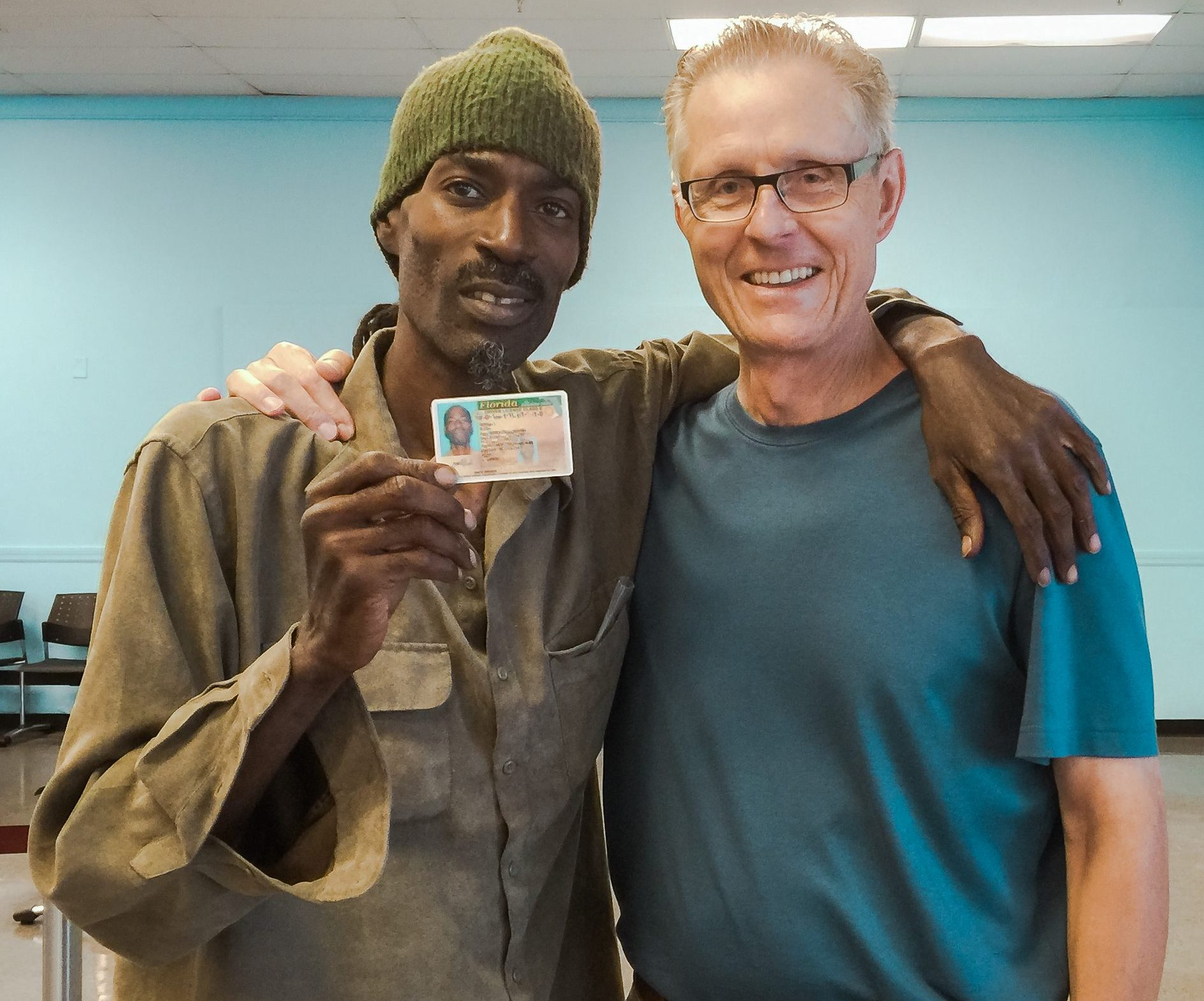 IDignity client Donell celebrates getting his new ID with IDignity Board Member Nick