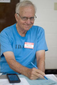 IDignity volunteer Warren smiles for the camera