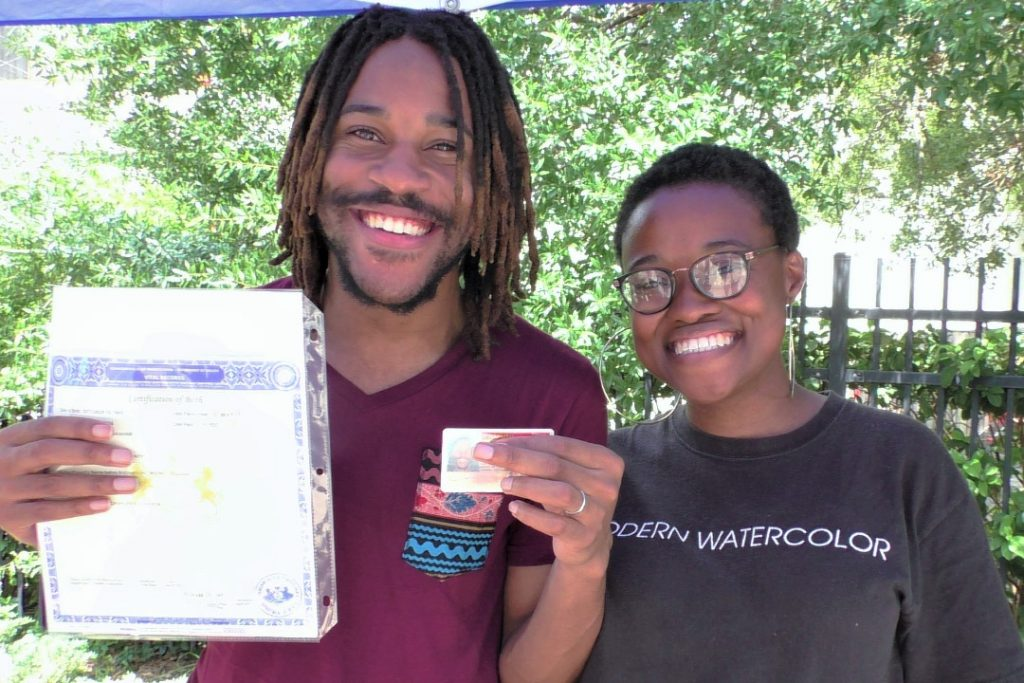 Rahsaan celebrates receiving his new ID and birth certificate with his wife
