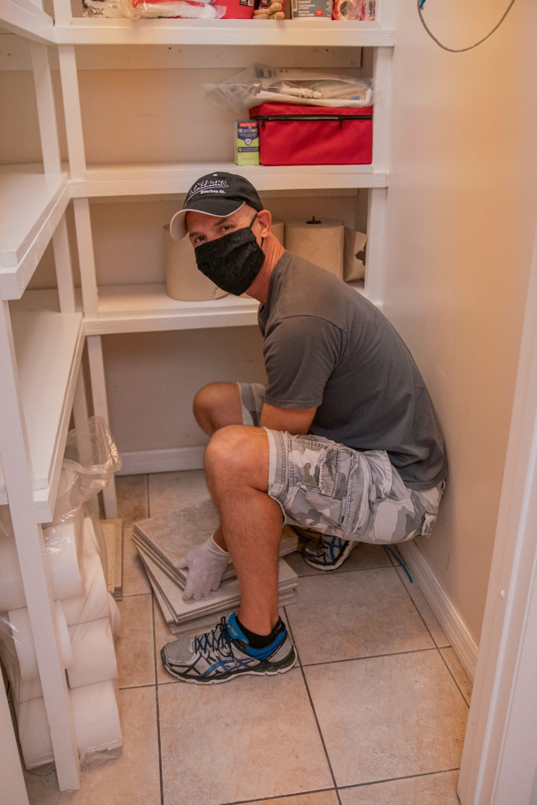 A volunteer organizes the closet