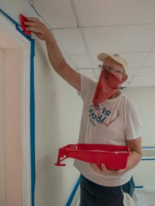 A volunteer painting Jackie's Place