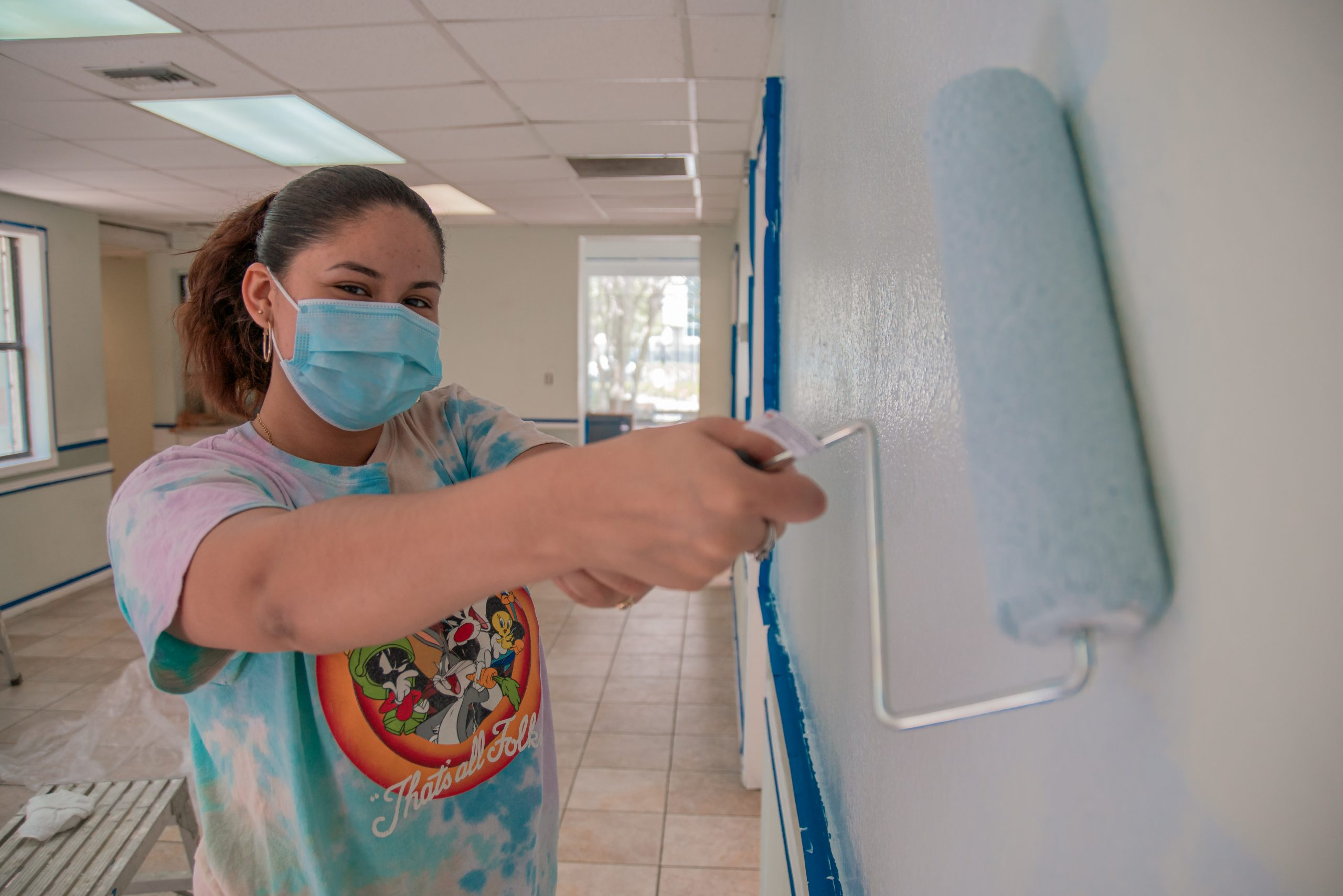 A volunteer paints the walls in Jackie's Place