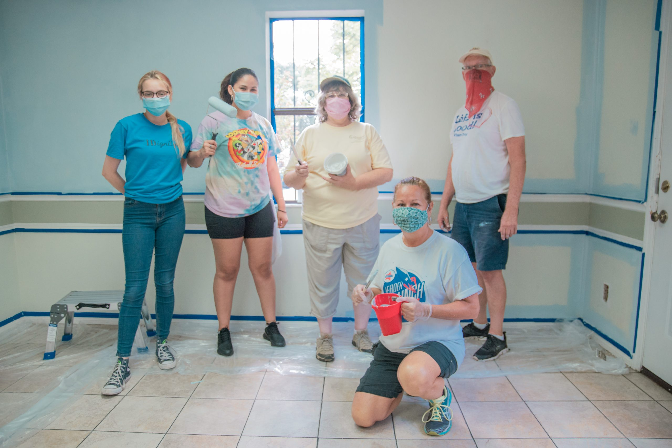 The volunteer painting team