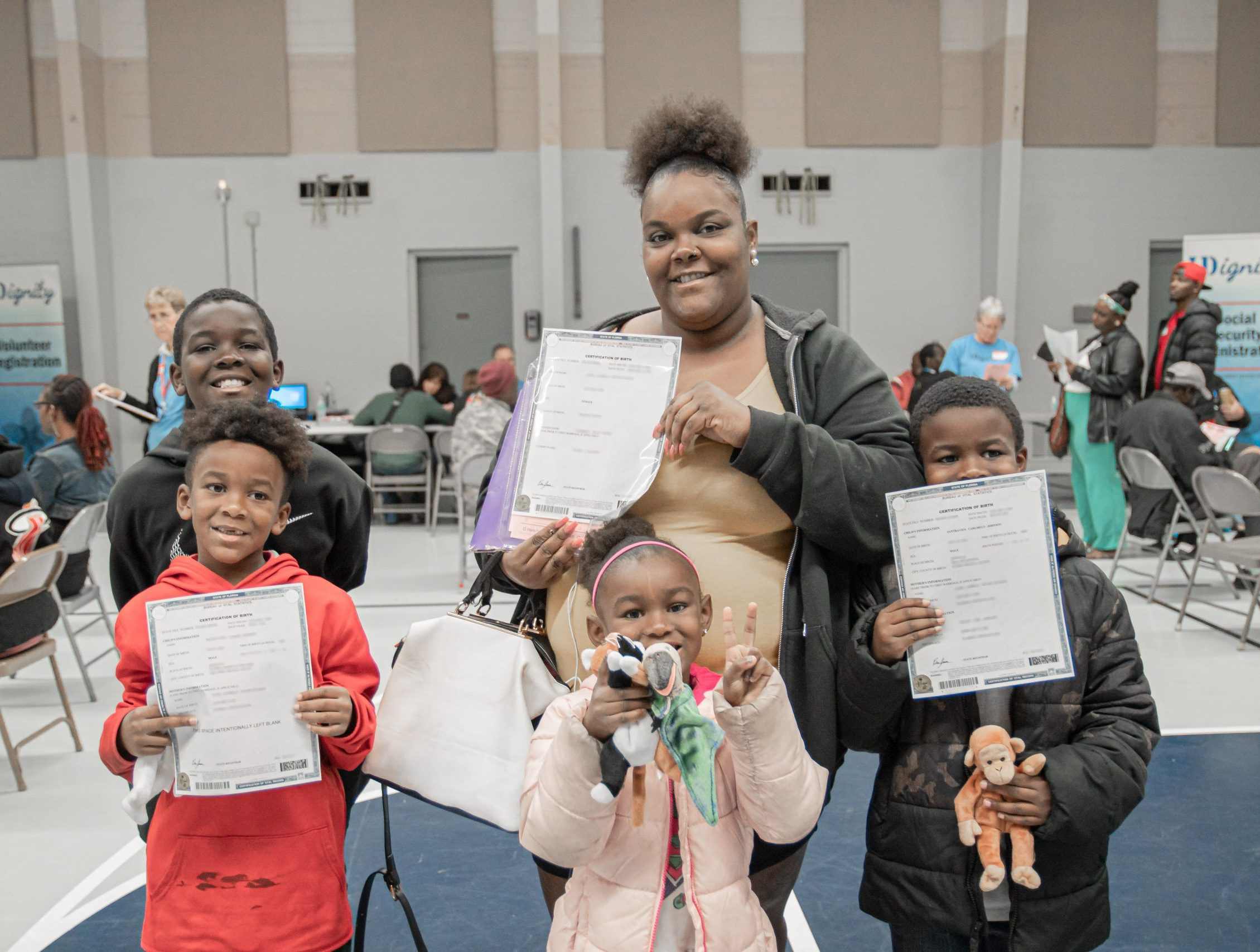 A family of clients with new copies of their birth certificates