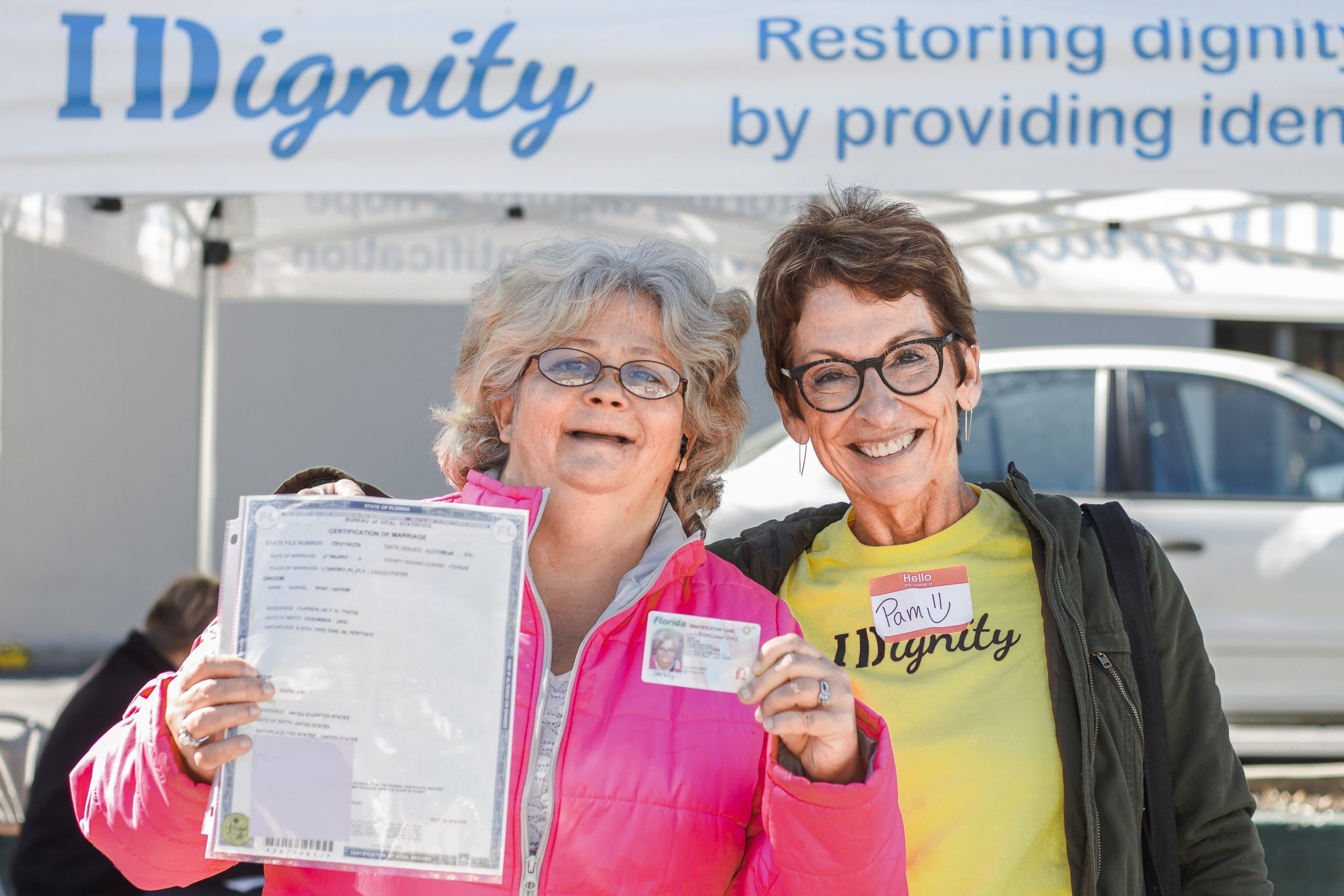 IDignity volunteer Pam with a happy client