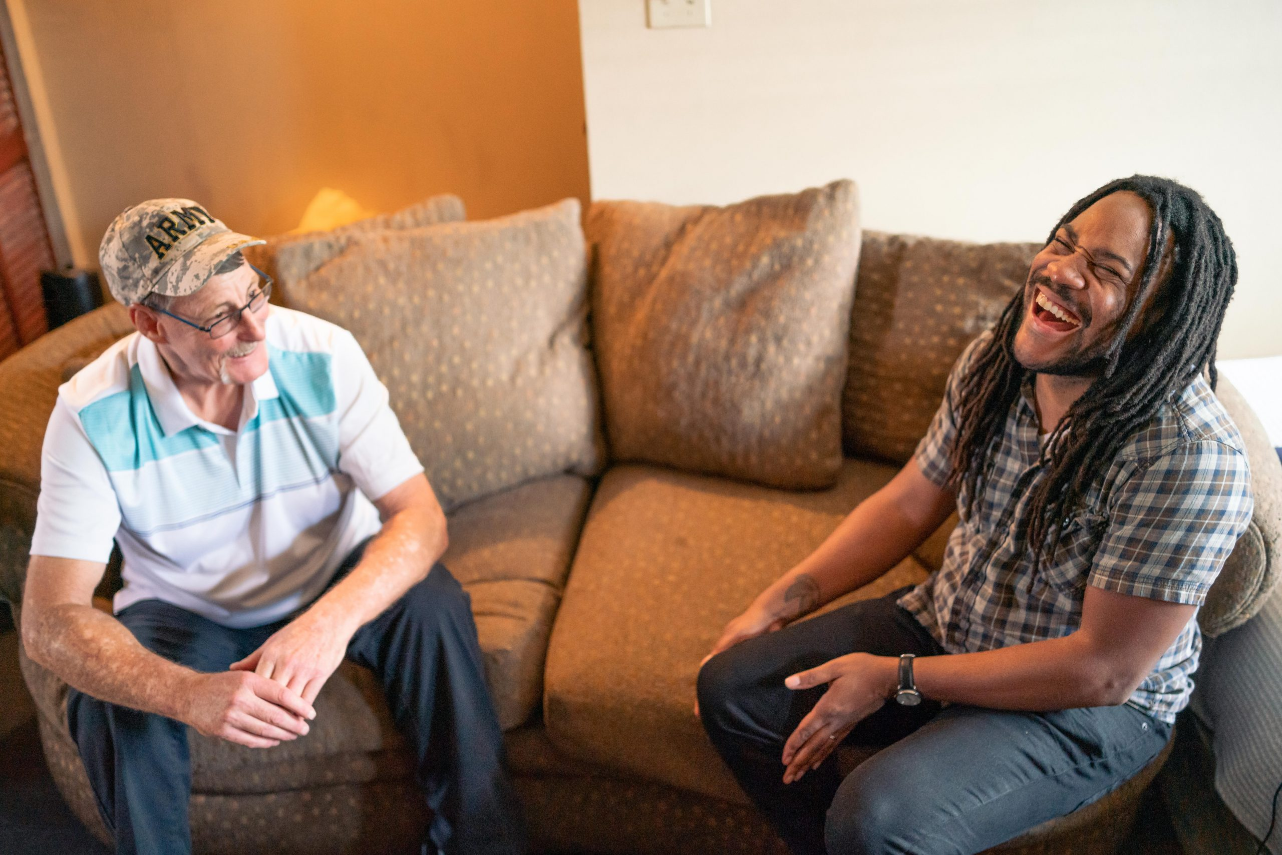Former IDignity clients Chris and Rahsaan laughing over a conversation together.